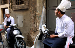 Italian cooks. While they have a conversation Stock Photography