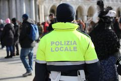 Free Italian Cop With Uniform With The Text POLIZIA LOCALE Which Mean Royalty Free Stock Photography - 137683787