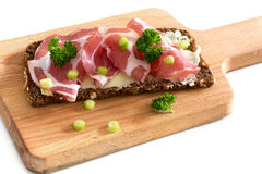 Italian coppa or capicola ham on dark bread on a wooden cutting Stock Photography