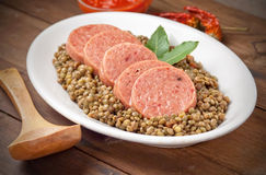 Italian cotechino with lentils Royalty Free Stock Photos