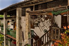 Italian country building with farm tools and furniture hanging on wall stock photography