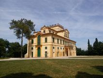Italian country house in the ancient tradition. Italian Villa for rest at the week end. Italian country house in the ancient tradition among green field and Royalty Free Stock Image