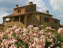 Italian country villa. A country villa in Tuscany, fronted by beautiful flower gardens. This is also a rental property stock photos