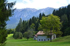 Italian countryside home and Dolomite mountains Stock Photo