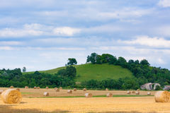 Italian countryside panorama. Round bales on wheat field Royalty Free Stock Photos