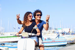 Italian Couple on Scooter Having Fun Royalty Free Stock Photography