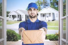 Italian courier giving a package to homeowner Royalty Free Stock Photos