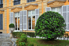 Italian court with a round bush Royalty Free Stock Photo