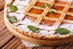 Italian crostata with apricot jam and mint macro horizontal Royalty Free Stock Photography