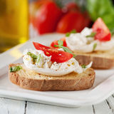 Italian crostini. With mozzarella, tomato and basil, selective focus and square image Royalty Free Stock Photos