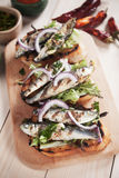 Italian crostini sandwich with grilled sardine fish Stock Photos