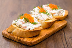 Italian Crostini on a wooden board Royalty Free Stock Image