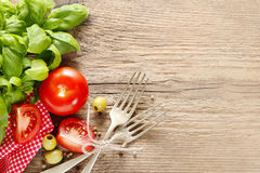Italian cuisine background: tomatoes, olives and peppers Stock Photo