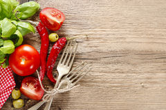 Italian cuisine background: tomatoes, olives and peppers Royalty Free Stock Image