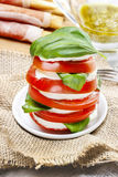 Italian cuisine: caprese salad and breadsticks Stock Images