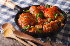 Italian cuisine: Chicken Cacciatori close up in a pan. Horizonta Stock Photos