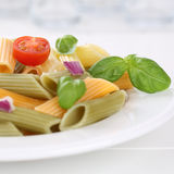 Italian cuisine colorful Penne Rigate noodles pasta meal with to Stock Photo