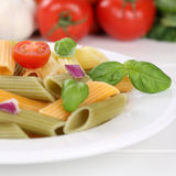 Italian cuisine colorful Penne Rigatoni noodles pasta meal with Stock Image