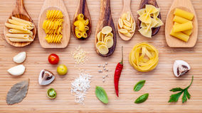 Italian cuisine concept .Various kind of pasta in wooden spoons Royalty Free Stock Images