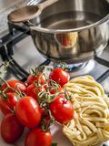 Italian cuisine, Cooking homemade spaghetti with a tomato. Cooking spaghetti noodles pasta food with tomato sauce, Italian cuisine Royalty Free Stock Photo