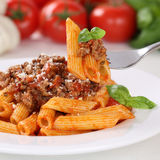 Italian cuisine eating pasta Bolognese sauce noodles meal Stock Images