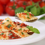 Italian cuisine eating Pasta Ravioli with tomato sauce noodles m Stock Images