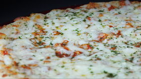 Italian Cuisine: Four Cheese Pizza Slowly Turning in Display stock video footage