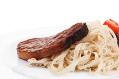 Italian cuisine : grilled beef steak with pasta Royalty Free Stock Image