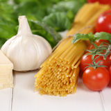 Italian cuisine ingredients for spaghetti pasta noodles meal wit Royalty Free Stock Images