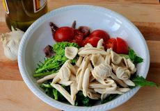 Italian Cuisine - orecchiette and turnip greens Royalty Free Stock Images