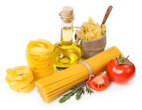 Italian cuisine. Pasta, a bottle of oil, tomatoes, spices Stock Photo