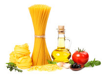 Italian cuisine. Pasta, a bottle of oil, tomatoes, spices Stock Photos