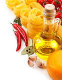 Italian cuisine. Pasta, a bottle of oil, tomatoes, spices Stock Images