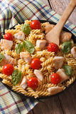 Italian cuisine: Pasta fusilli with chicken, cherry tomatoes and Royalty Free Stock Photography