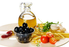 Italian cuisine - pasta and olive oil Royalty Free Stock Images