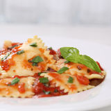 Italian cuisine Pasta Ravioli with tomato sauce noodles meal Stock Photography