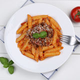 Italian cuisine penne Rigate Bolognese sauce noodles pasta meal Royalty Free Stock Photo