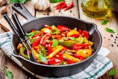 Italian cuisine, peperonata: roasted bell pepper with capers and basil Stock Photos