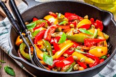 Italian cuisine, peperonata: roasted bell pepper with capers and basil Royalty Free Stock Images