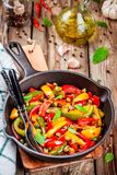 Italian cuisine, peperonata: roasted bell pepper with capers and basil Stock Photo
