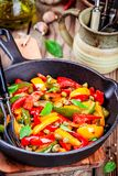 Italian cuisine, peperonata: roasted bell pepper with capers and basil Stock Photography