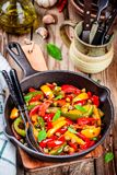 Italian cuisine, peperonata: roasted bell pepper with capers and basil Royalty Free Stock Photo