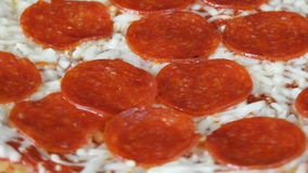 Italian Cuisine: Pepperoni Pizza Slowly Turning in Display stock video footage