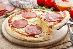 Italian cuisine: pizza with salami Stock Image