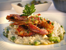 Italian Cuisine. Risotto with prawns in a bowl on a light background. Royalty Free Stock Images