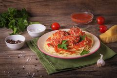 Italian cuisine spaghetti with meatballs noodles pasta meal in a plate on a rustic wooden background.  stock photo