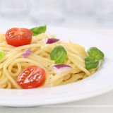 Italian cuisine spaghetti with tomatoes noodles pasta on a plate Royalty Free Stock Photography