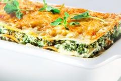 Italian cuisine. Spinach lasagna with basil. Macro Stock Photos