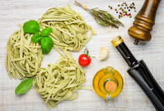 Italian Cuisine Tagliatelle Pasta and Ingredients Royalty Free Stock Photography