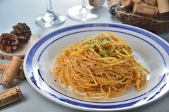 Garlic Spagetti. Italian cuisine Tomato Garlic Spagetti royalty free stock photos
